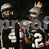 Rob Winner – rwinner@shawmedia.com<br /> <br /> Kaneland quarterback Drew David (4) taps the helmet of Quinn Buschbacher after his third touchdown reception during the first quarter in Maple Park, Ill., on Friday, Oct. 7, 2011.