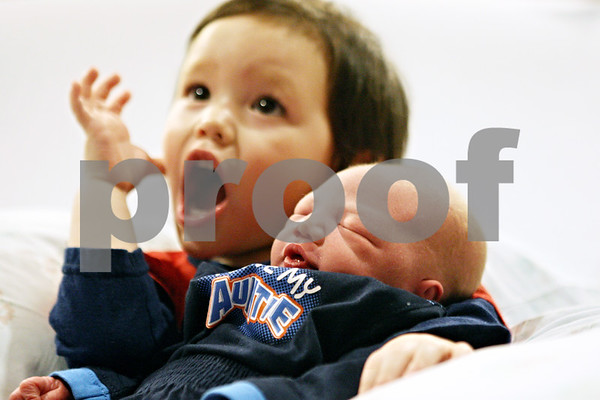 Rob Winner – rwinner@daily-chronicle.com<br /> <br /> Landon Cagle, 2, holds his newborn baby brother Hunter Cagle at Kishwaukee Community Hospital in DeKalb, Ill. on Saturday, January 1, 2011. Hunter was born at 5:27 a.m. New Year's Day and is the first baby born in DeKalb county this year.
