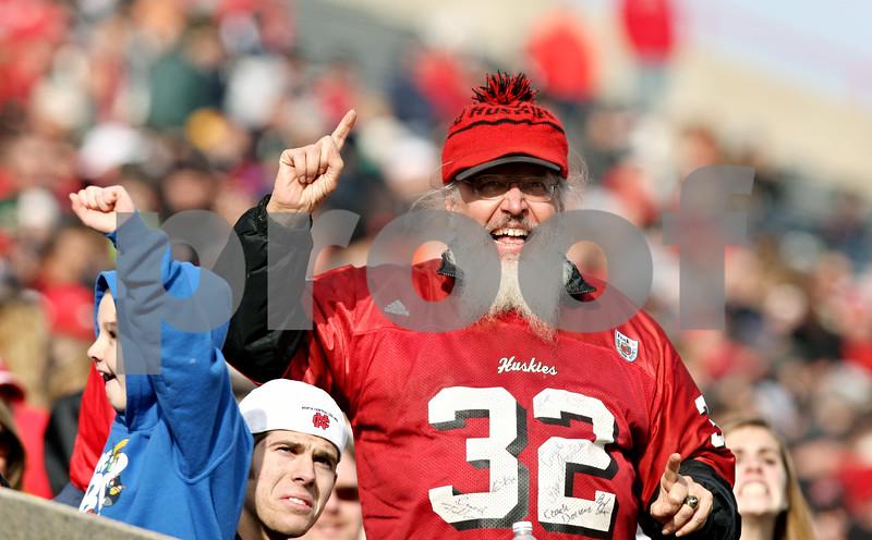 Rob Winner – rwinner@shawmedia.com<br /> <br /> A Northern Illinois fan cheers during the first quarter in DeKalb, Ill., on Friday, Nov. 25, 2011. Northern Illinois defeated Eastern Michigan, 18-12.