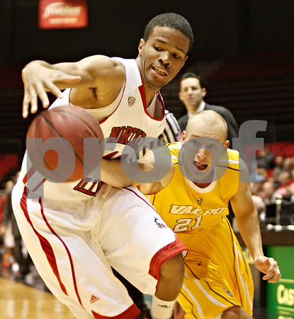 Rob Winner – rwinner@shawmedia.com<br /> <br /> Northern Illinois forward Jeremiah Jackson (left) is fouled by Valparaiso guard Will Bogan (21) during the first half on Tuesday, Dec. 20, 2011, in DeKalb, Ill.