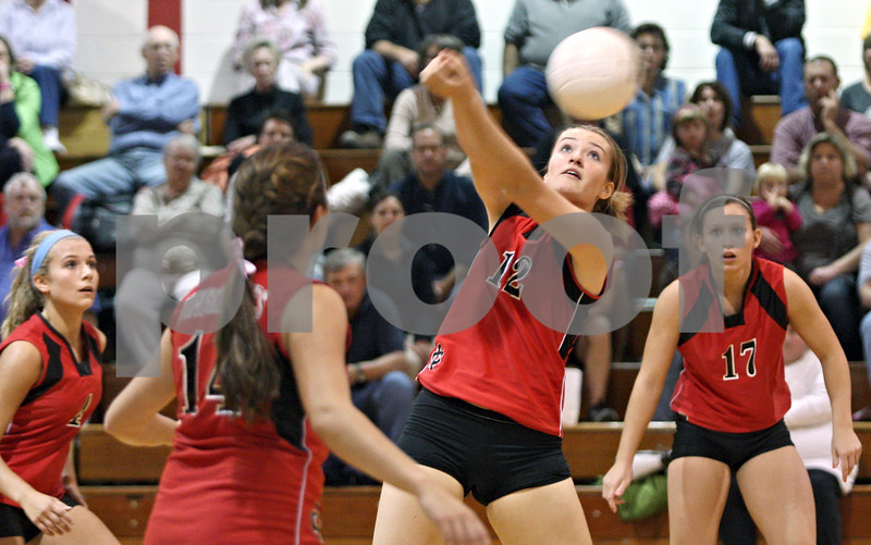 Rob Winner – rwinner@shawmedia.com<br /> <br /> Indian Creek's Nicole Goodrich (12) controls a ball during the first game while hosting Serena in Shabbona on Thursday, Sept. 22, 2011. Indian Creek was defeated by Serena, 25-22, 10-25, and 25-22.