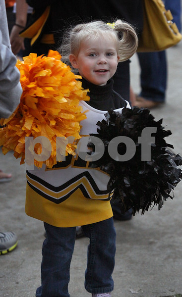 Wendy Kemp - For The Daily Chronicle<br /> Young Sycamore fan, Brady Snodgrass, 2, cheers for her team at Huskie Stadium on Friday.<br /> DeKalb 9/9/11