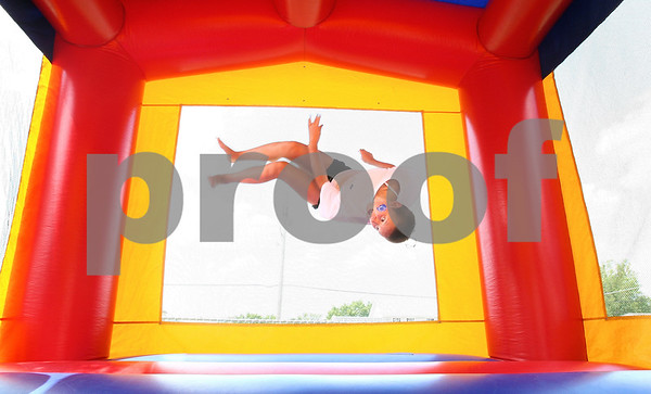 Kyle Bursaw – kbursaw@daily-chronicle.com<br /> <br /> Nina Day, 10, does a flip while playing in a bounce room at Sandwich Freedom Days on Saturday, July 2, 2011. Day recently took first place in her age group at the 2011 YMCA National Championship for gymnastics in Toledo.