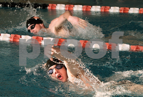 Kyle Bursaw – kbursaw@daily-chronicle.com<br /> <br /> Brothers Josh (front) and Cody Page swim laps at the DeKalb high school pool on Wednesday, Feb. 16, 2011.