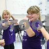 Rob Winner – rwinner@shawmedia.com<br /> <br /> Third grader Julia Johnson is recognized at the end of a Girls on the Run meeting on Tuesday at South Prairie Elementary School in Sycamore. Girls on the Run is a national program designed to help boost self esteem and promote physical activity for girls in third through fifth grades.