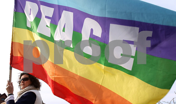 Kyle Bursaw – kbursaw@daily-chronicle.com<br /> <br /> Lolly Voss, co-coodinator of the DeKalb Interfaith Network for Peace & Justice, holds a peace flag at Memorial Park in DeKalb, Ill. on Friday, March 18, 2011.