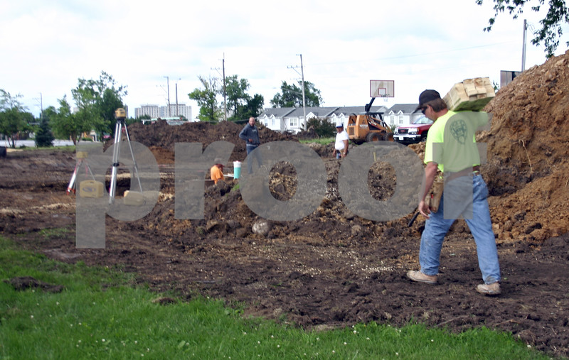 Constructions continue their work on the Hope Haven expansion during the homeless shelter's groundbreaking ceremony Friday. DeKalb based Irving Construction was hired as the project's contractor.<br /> By ANDREW MITCHELL — amitchell@daily-chronicle.com