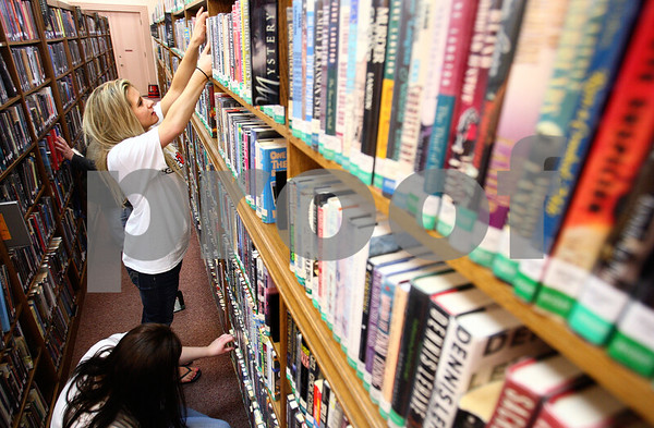 Kyle Bursaw – kbursaw@daily-chronicle.com<br /> <br /> Jessica Kasos helps make sure the shelves are neat and alphabetically organized in the fiction section at DeKalb Public Library on Saturday, April 16, 2011. Kasos and other NIU students volunteered throughout the community as part of NIU Cares Day.