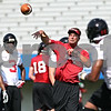 Rob Winner – rwinner@daily-chronicle.com<br /> <br /> Receivers coach Bob Cole throws a pass to receiver Willie Clark (right) during a drill at practice on Friday, Aug. 5, 2011, in DeKalb, Ill.