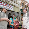 "Curtis Clegg - cclegg@shawsuburban.com<br /> <br /> Nichole Eidsmoe (center) and self-proclaimed ""libertarian activist"" Ted McCarron (right), both of DeKalb, get into a heated discussion about the legalities of breast feeding in public places in front of the No Strings Attached resale shop in DeKalb on Thursday, June 2, 2011. Eidsmoe claims she was asked not to breast feed her daughter in the shop on Tuesday.  At left is Eidsmoe's fiance John Ehle, also of DeKalb."