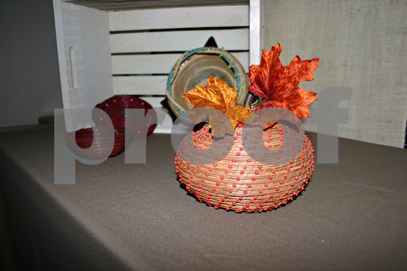 Though Cudden often likes to create more functional baskets than decoratives, this one styled like a pumpkin is an exception.<br /> By ANDREW MITCHELL — amitchell@daily-chronicle.com