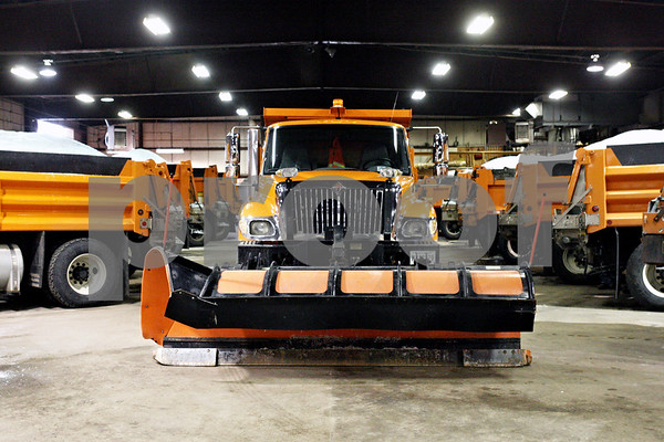 Rob Winner – rwinner@daily-chronicle.com<br /> <br /> Snow plow trucks are readied for the winter storm in DeKalb on Monday afternoon.