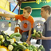 Rob Winner – rwinner@shawmedia.com<br /> <br /> Brothers Riley Kleinprinz (left), 13, and Brody Kleinprinz, 16, of Leland, help display squash within the Horticulture Building on the Sandwich Fairgrounds in Sandwich, Ill., on Monday, Sept. 5, 2011. The 124th annual Sandwich Fair begins this Wednesday and runs until Sunday.