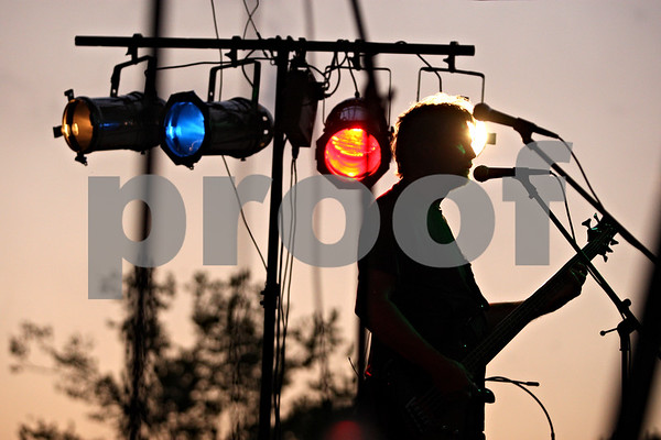 Rob Winner – rwinner@daily-chronicle.com<br /> <br /> Bassist Dave Miller plays with his band Back Country Roads as Cortland Summer Fest kicked off at Cortland Community Park on Friday evening.