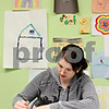 Rob Winner – rwinner@daily-chronicle.com<br /> <br /> Lauren Adams, who is a family advocate for residential clients at Safe Passage in DeKalb, colors with crayons while two young children sleep in the kids counseling building on Wednesday, Feb. 23, 2011.