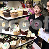 Kyle Bursaw – kbursaw@daily-chronicle.com<br /> <br /> Travis and Deanna Donnelly decide on which cupcake they want to sample from Sweet Dream Desserts' table at the Community Expo at Sycamore high school on Tuesday, March 22, 2011.