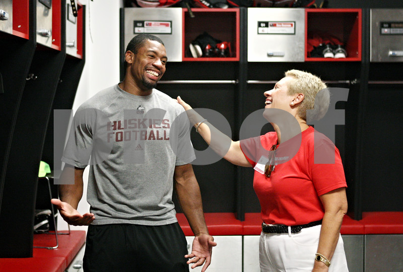 Rob Winner – rwinner@daily-chronicle.com<br /> <br /> Northern Illinois defensive back Tommy Davis (left) talks with Lyn Rasmussen, of Chicago, while walking through the locker room during the third annual Football 101 Women's Clinic at the Yordon Center in DeKalb on Wednesday night.