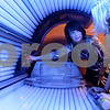 "Kyle Bursaw – kbursaw@daily-chronicle.com<br /> <br /> Dynamic Tanning co-owner Teresa Lynch, explains how to use a tanning bed called ""The Race"" to Tara Kraabel prior to her using it at their Sycamore road location in DeKalb, Ill. on Tuesday, March 8, 2011. Kraabel is a returning customer, but had not previously used that type of bed."