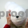 Rob Winner – rwinner@daily-chronicle.com<br /> <br /> Pikatti, a robotic seal, reacts to the touches of Eva Beardsley in the dementia care unit at the Pine Acres Nursing Home and Rehabilitation Care Center in DeKalb on Monday morning. Pikatti was brought to Pine Acres by Corey Tague of Passages Hospice in Rockford.