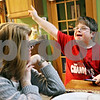 Rob Winner – rwinner@daily-chronicle.com<br /> <br /> Barb Castritsis watches as her son, Michael Castritsis, 11, reacts while playing a video game at their Sycamore home on Tuesday evening. Barb is involved with a support group which has been created for parents of special education students within the Sycamore school district.