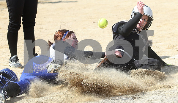 Kyle Bursaw – kbursaw@daily-chronicle.com<br /> <br /> Newark's Dallas Sigmund loses hold of the ball as Sycamore's Becca Schroeder slides into home during the first game of a doubleheader against Newark in Sycamore, Ill. on Saturday, March 19, 2011.
