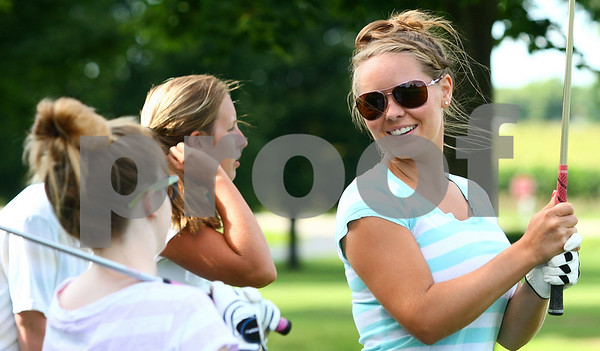 Kyle Bursaw – kbursaw@daily-chronicle.com<br /> <br /> Hinckley-Big Rock's Brittany Herrmann (right) talks with her teammates at golf practice at Indian Oaks Golf Course on Wednesday, Aug. 10, 2011.