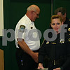 Jeff Engelhardt – Cortland Police officer Kimberly Everhart smiles after receiving the Medal of Valor from Cortland Police Chief Dennis Medema (left) and DeKalb County Sheriff Roger Scott (right) Monday at the Cortland Town Hall meeting. The national award was given to Everhart for saving two people in a July shooting.