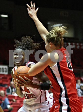 Rob Winner – rwinner@daily-chronicle.com<br /> <br /> Northern Illinois center Ebony Ellis looks to take a shot over Ball State forward Emily Maggert during the first half in DeKalb, Ill. on Wednesday, Jan. 19, 2011.