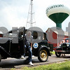Kyle Bursaw – kbursaw@daily-chronicle.com<br /> <br /> Tony Whitney gets out of his 1931 Ford Fordor after arriving at the Family Fun Day at the Sycamore History Museum. Whitney's vintage car and the 1931 Ford Tudor behind it were just one of the attractions during the event on Saturday, Aug. 13, 2011.