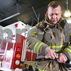 Kyle Bursaw – kbursaw@daily-chronicle.com<br /> <br /> Lt. Shaun Penn suits up to practice some  hose techniques in the full gear he'd wear in a normal fire at Station no. 2 in Sycamore, Ill. on Thursday, Feb. 24, 2011. Penn recently returned from serving the military in Afghanistan. After about a year away from being a firefighter, Penn spent a lot of time in his first week reacquainting himself with critical techniques of the job, before returning to normal shifts.