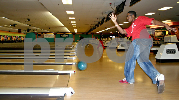 Joshua Singleton, a sophomore at Northern Illinois University and community service director for NIU's Black Male Initiative, bowls with his team Saturday at Mardi Gras Lanes in DeKalb during the 30th annual Bowl for Kids' Sake fundraiser for the DeKalb County Big Brothers, Big Sisters organization.