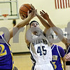Rob Winner – rwinner@daily-chronicle.com<br /> <br /> Paw Paw's Casey Marks (22) fouls Hiawatha's Jeff Tamraz (45) during the fourth quarter of their Little Ten tournament game in Somonauk, Ill., on Monday, January 31, 2011. Paw Paw defeated Hiawatha, 68-65.