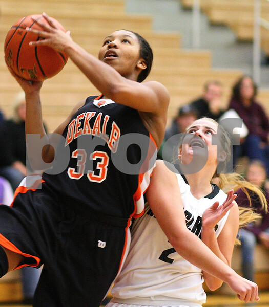 Kyle Bursaw – kbursaw@shawmedia.com<br /> <br /> DeKalb's Courtney Patrick shoots over the defense of Kaneland's Sarah Grams<br /> during the first quarter of their game at Kaneland High School on Tuesday, Dec. 13, 2011.