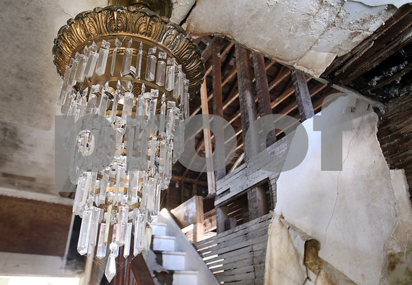 Kyle Bursaw – kbursaw@daily-chronicle.com<br /> <br /> While some parts of Isaac Ellwood's former home at 315 N. Third Street in DeKalb are in disrepair, other period items like this chandelier remain intact. <br /> <br /> Thursday, Feb. 10, 2011.