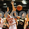 Rob Winner – rwinner@daily-chronicle.com<br /> <br /> DeKalb's Taylor White (20) and Sycamore's Jessica Pluhm (30) look to rebound a missed free throw by Pluhm during the fourth quarter of Friday night's game at the Convocation Center in DeKalb, Ill., on Friday, January 28, 2011. DeKalb defeated Sycamore, 30-21.