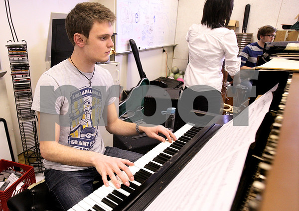 Kyle Bursaw – kbursaw@daily-chronicle.com<br /> <br /> Harrison Hintzsche plays piano during jazz ensemble practice at DeKalb high school on Friday, April 1, 2011.