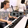 Kyle Bursaw – kbursaw@daily-chronicle.com<br /> <br /> Harrison Hintzsche plays piano during jazz ensemble practice at DeKalb high school on Friday, April 1, 2011.