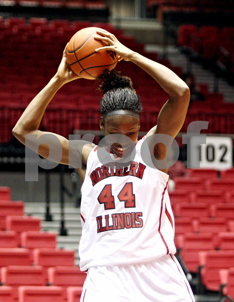 Rob Winner – rwinner@daily-chronicle.com<br /> <br /> Northern Illinois center Ebony Ellis controls a rebound and then realizes she stepped out of bounds during the first half in DeKalb, Ill. on Wednesday, Jan. 5, 2011.