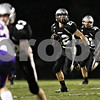 Rob Winner – rwinner@shawmedia.com<br /> <br /> Kaneland's Quinn Buschbacher returns a punt during the first quarter in Maple Park on Friday, Oct. 28, 2011.
