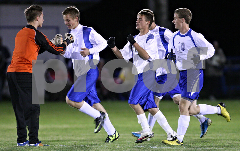 Rob Winner – rwinner@shawmedia.com<br /> <br /> Hinckley-Big Rock goalkeeper Forrest Grivetti (left) congratulates Bernie Conley (center) after Conley's goal in the first half in Hinckley on Tuesday, October 18, 2011. H-BR defeated Genoa Kingston, 3-2, during the Class 1A Hinckley-Big Rock Sectional semifinal.
