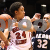 Kyle Bursaw – kbursaw@daily-chronicle.com<br /> <br /> Northern Illinois' Kim Davis (24) looks to pass as Akron's Rachel Tecca (32) defends. The Huskies fell to the Zips 72-43 in DeKalb, Ill. onSaturday, Feb. 5, 2011.