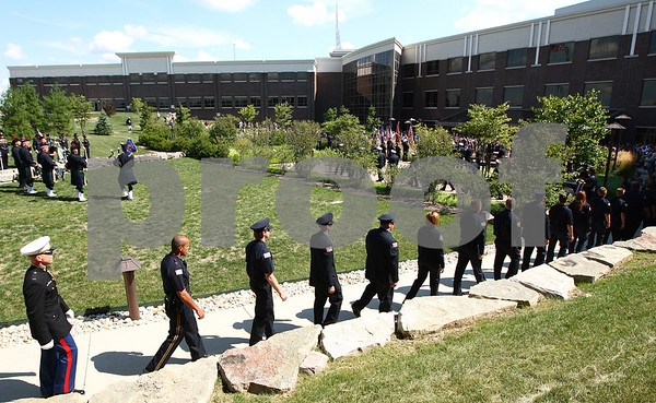 Kyle Bursaw – kbursaw@shawmedia.com<br /> <br /> Members of area fire and police departments file in to a Sept. 11 memorial ceremony at the healing garden of Kishwaukee Community Hospital in Sycamore, Ill. on Sunday, Sept. 11, 2011.