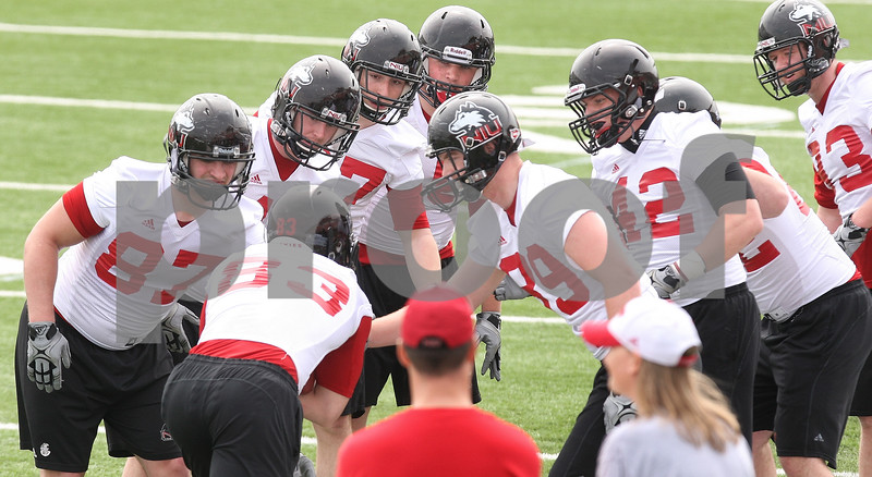Kyle Bursaw – kbursaw@daily-chronicle.com<br /> <br /> Luke Eakes (83) plows his way through the arms of teammates trying to strip the ball from him during practice at Huskie Stadium on Saturday, April 9, 2011.