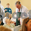 "Rob Winner – rwinner@daily-chronicle.com<br /> <br /> Sycamore Vera Anderson (left) speaks to state Representative Bob Pritchard, who was serving croissants and coffee, during the fourth annual ""Meals for Moms"" luncheon hosted by the Voluntary Action Center at the Regale Center in Sycamore on Monday afternoon."