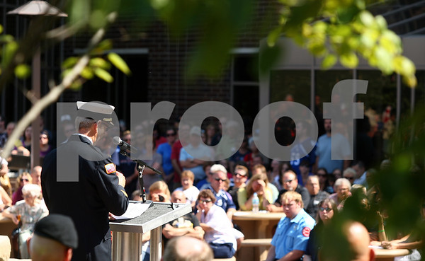 Kyle Bursaw – kbursaw@shawmedia.com<br /> <br /> Sycamore Fire Chief Mark Kessler addresses those gathered at a Sept. 11 memorial ceremony at the healing garden of Kishwaukee Community Hospital in Sycamore, Ill. on Sunday, Sept. 11, 2011.