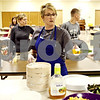 Rob Winner – rwinner@daily-chronicle.com<br /> <br /> Lisa Primrose, of DeKalb, prepares a plate of food during Feed'Em Soup's first official meal serving at the First Lutheran Church of DeKalb on Friday October 13, 2010.