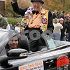 "Wendy Kemp - For The Daily Chronicle<br /> ""Mr. Pumpkin"" Wally Thurow waves to the crowd during the annual Pumpkin Parade in Sycamore on Sunday.<br /> Sycamore 10/30/11"