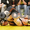 Rob Winner – rwinner@daily-chronicle.com<br /> <br /> Sycamore's Kyle Akins (left) and DeKalb's Patrick Martin wrestle in the 112-pound match on Thursday, Jan. 13, 2011 in Sycamore, Ill. Akins eventually pinned Martin.