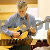 Rob Winner – rwinner@shawmedia.com<br /> <br /> Choir director Harvey Blau practices the guitar before a Rosh Hashanah service at the Northern Illinois University Holmes Student Center in DeKalb on Wednesday, Sept. 28, 2011.