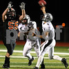 Kyle Bursaw – kbursaw@shawmedia.com<br /> <br /> DeKalb defensive lineman Joe Diedrich puts pressure on Kaneland quarterback Drew David during the first half of their game in DeKalb, Ill. on Friday, Sept. 30, 2011.